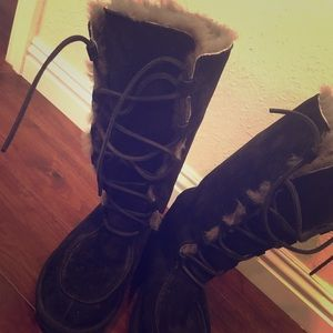Women's UGG tall lace up boots. Size 7.